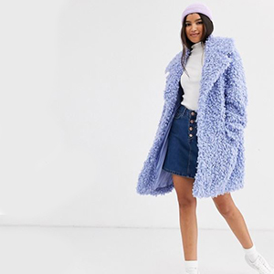 Woman wearing fluffy blue coat from ASOS photo