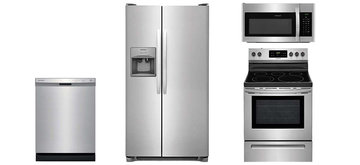 Stainless steel dishwasher, refrigerator, electric range, and microwave photo