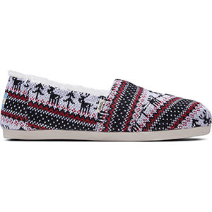 Red, black, and white fair isle printed TOMS shoes photo