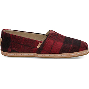 Red plaid print felt TOMS shoes with leather bottoms photo