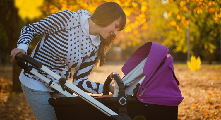 A woman with her baby in a stroller