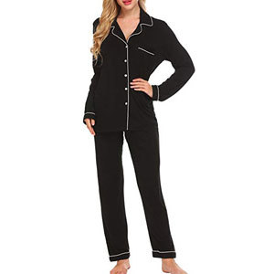 Woman in black pants and long sleeved buttoned pajama set from Amazon. photo