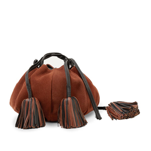 Tan suede shoulder bag with leather tassels. photo