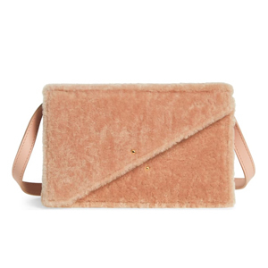 Salmon colored shearling crossbody bag with leather strap. photo