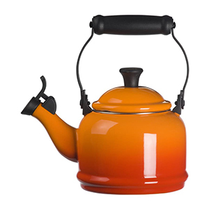 Orange and black Le Creuset tea kettle from Nordstrom photo