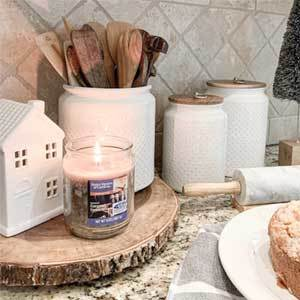 Kitchen countertop decorated with white decor and candle. photo