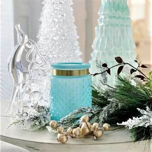 Blue candle holder with winter decorations. photo