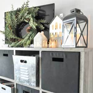 Cube entertainment center with galvanized bins and accessories. photo