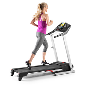 A woman runs on a Weslo treadmill from Walmart photo