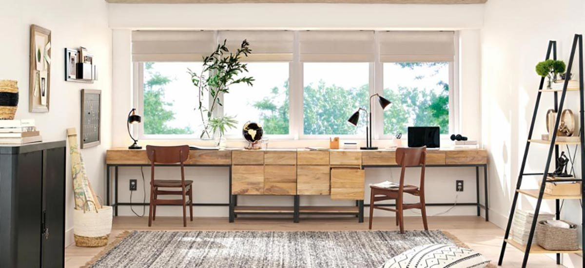 A home office is decorated with various space-saving furniture options