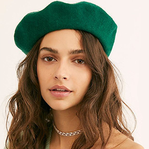 Woman wearing a green beret from Free People photo