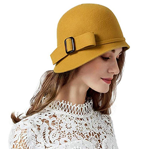 Woman wearing yellow bowler hat with buckle from Amazon photo