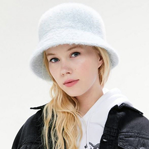 Woman with furry white bucket hat from Urban Outfitters photo