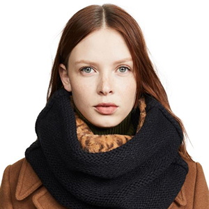 Woman wearing a brown coat and a black and cheetah print infinity scarf from Shopbop photo