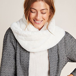Woman wearing a soft white infinity scarf from Anthropologie photo