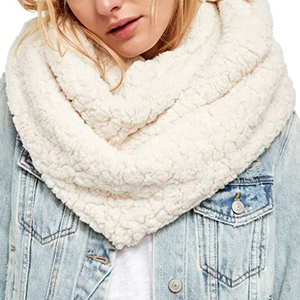 Woman wearing a jean jacket and a fluffy white infinity scarf from Nordstrom photo