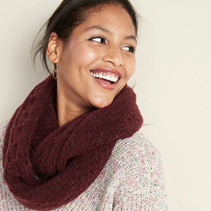 Woman wearing a maroon knitted infinity scarf from Old Navy photo