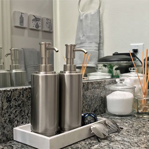 Bathroom sink with soap dispensers. photo