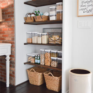 Organized kitchen pantry with bins and containers. photo