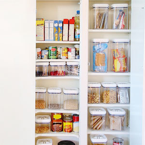 Organized kitchen pantry with clear food containers. photo