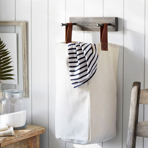 White laundry bag with handles and a shelf from Pottery Barn photo