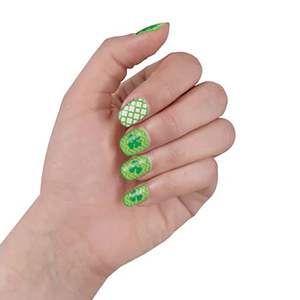 Hand with green nails and Saint Patrick's Day stickers from Michael's photo
