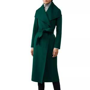 Woman in long emerald-colored wrap coat from Bloomingdales photo