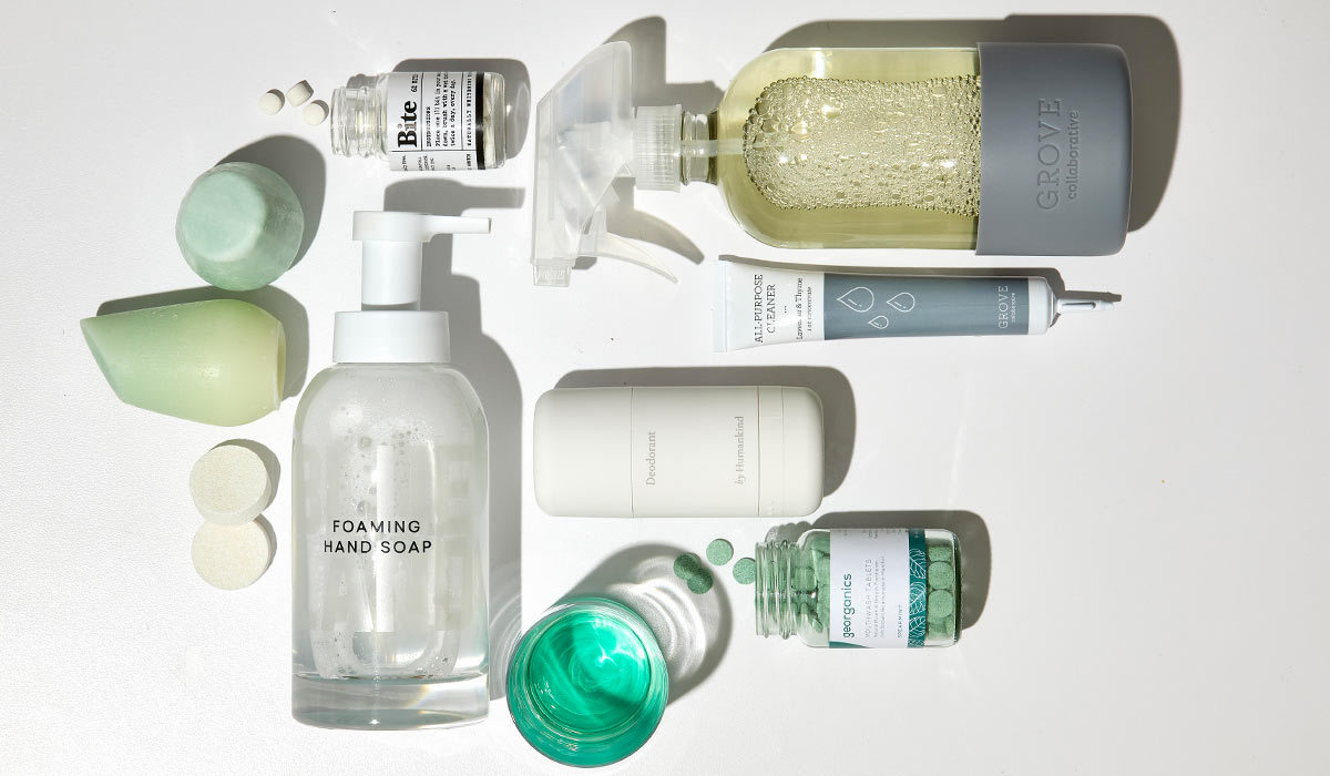 A spray bottle, hand soap, and toothpaste bits photo
