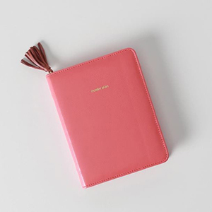 Pink leather journal with a zip-around enclosure from Nordstrom photo