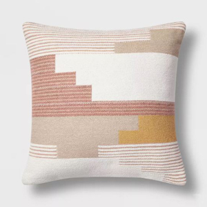 Geometric throw pillow in white, beige, pink, and yellow from Target photo