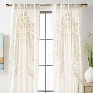 Sheer curtains with an embroidered leaf pattern from Anthropologie photo