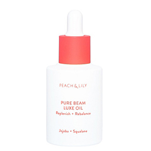 White and coral bottle of Peach & Lily Pure Beam Luxe Oil from Ulta photo
