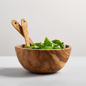 Wooden salad bowl with utensils from Pottery Barn photo