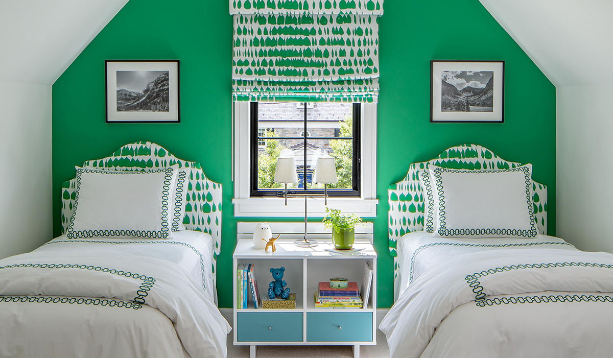 Two white twin beds side by side in a green bedroom photo