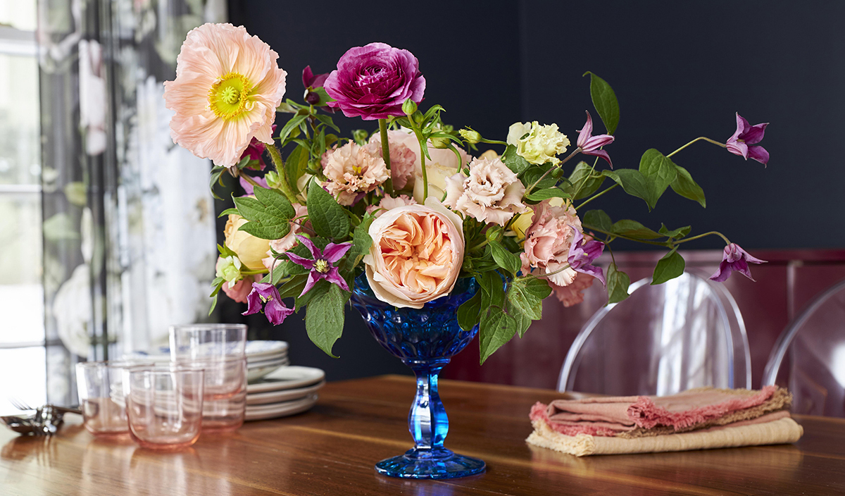 Vase of flowers on table photo