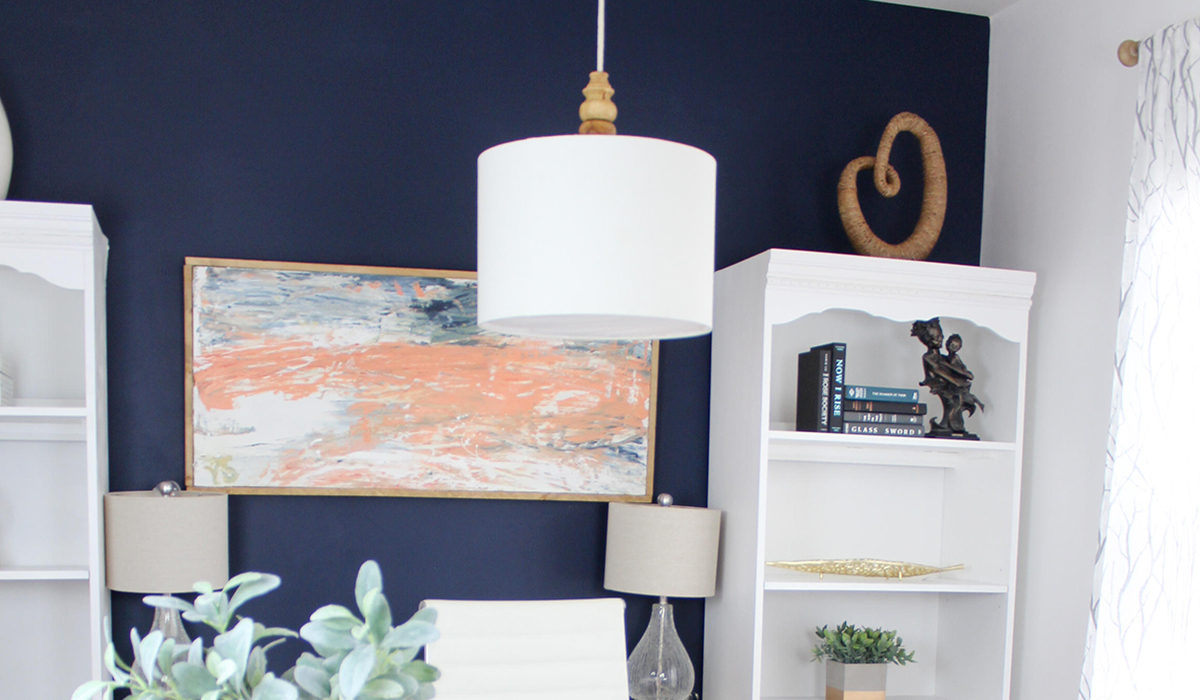Home office with desk and bookshelves in a blue and white room photo