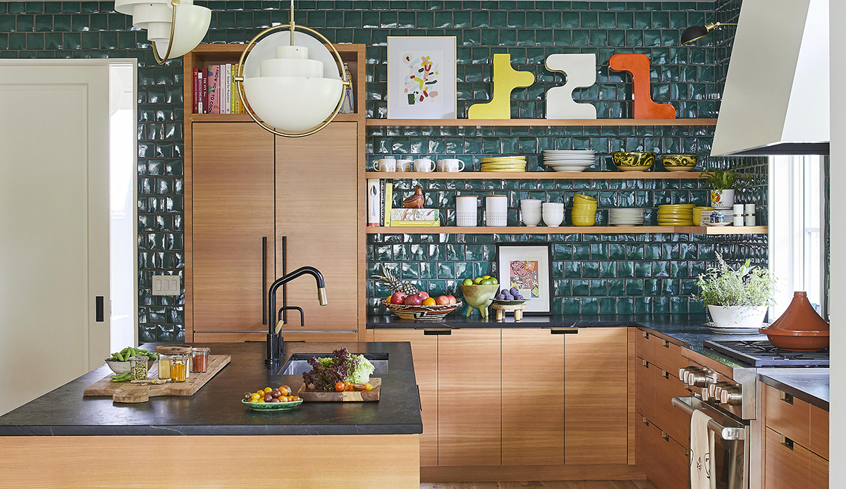 Green kitchen with light brown furnishings photo