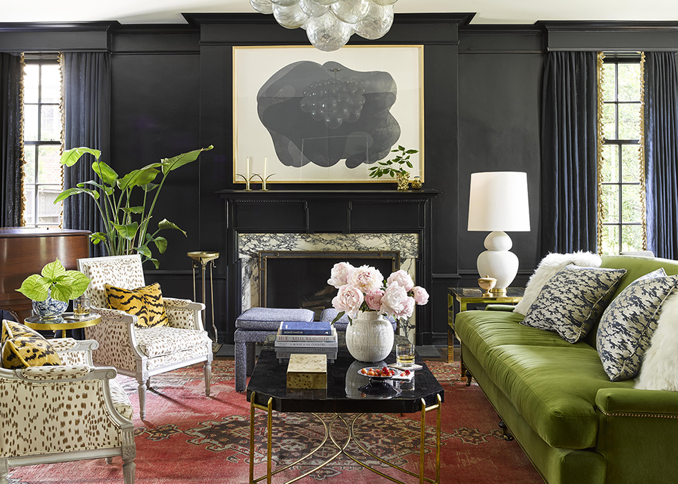 Green couch, white leopard print chairs in a black living room photo