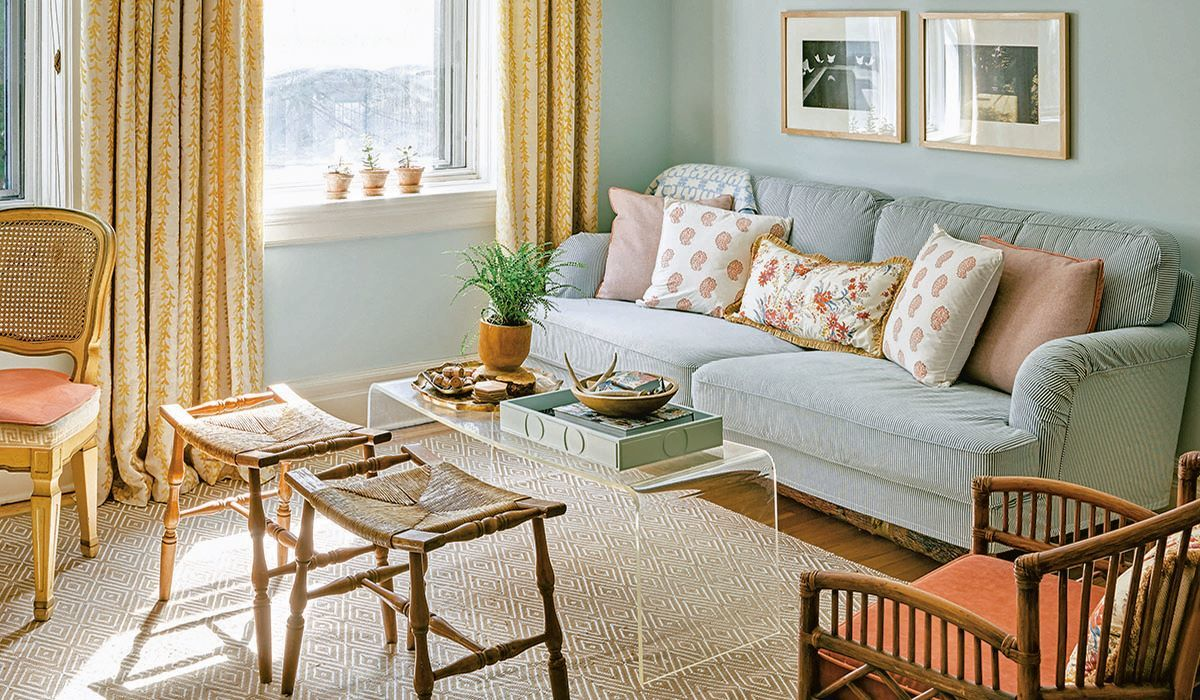 Gray couch with peach chairs in a gray living room