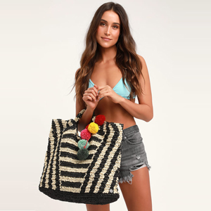 Talk to the Palm black striped pompom tote bag from Lulus photo