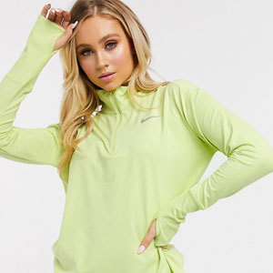 Woman in lime green Nike half-zip from Asos photo
