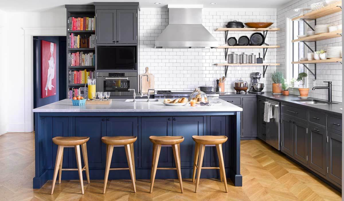 A kitchen with navy blue accents