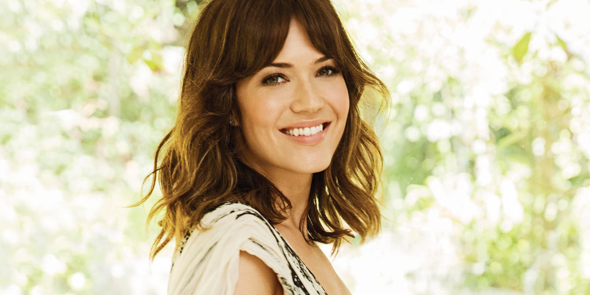 Mandy Moore with her hair curled and makeup done photo