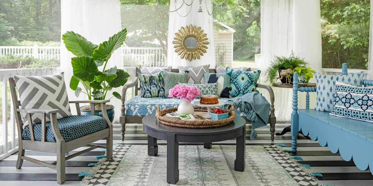 Porch featuring blue furniture and decor photo