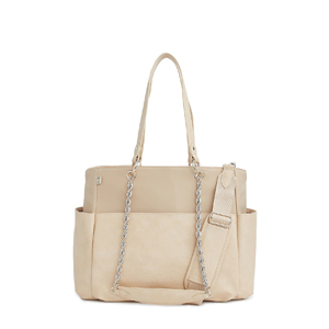 Tan colored diaper bag from Revolve photo