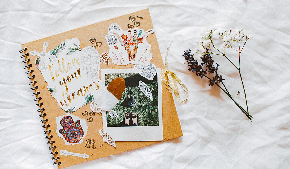 Scrapbook with pictures, quotes, and stickers