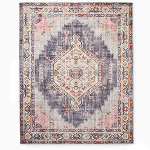 Pink textile rug from West Elm photo