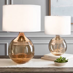 Two transparent rose gold table lamps from Pottery Barn photo