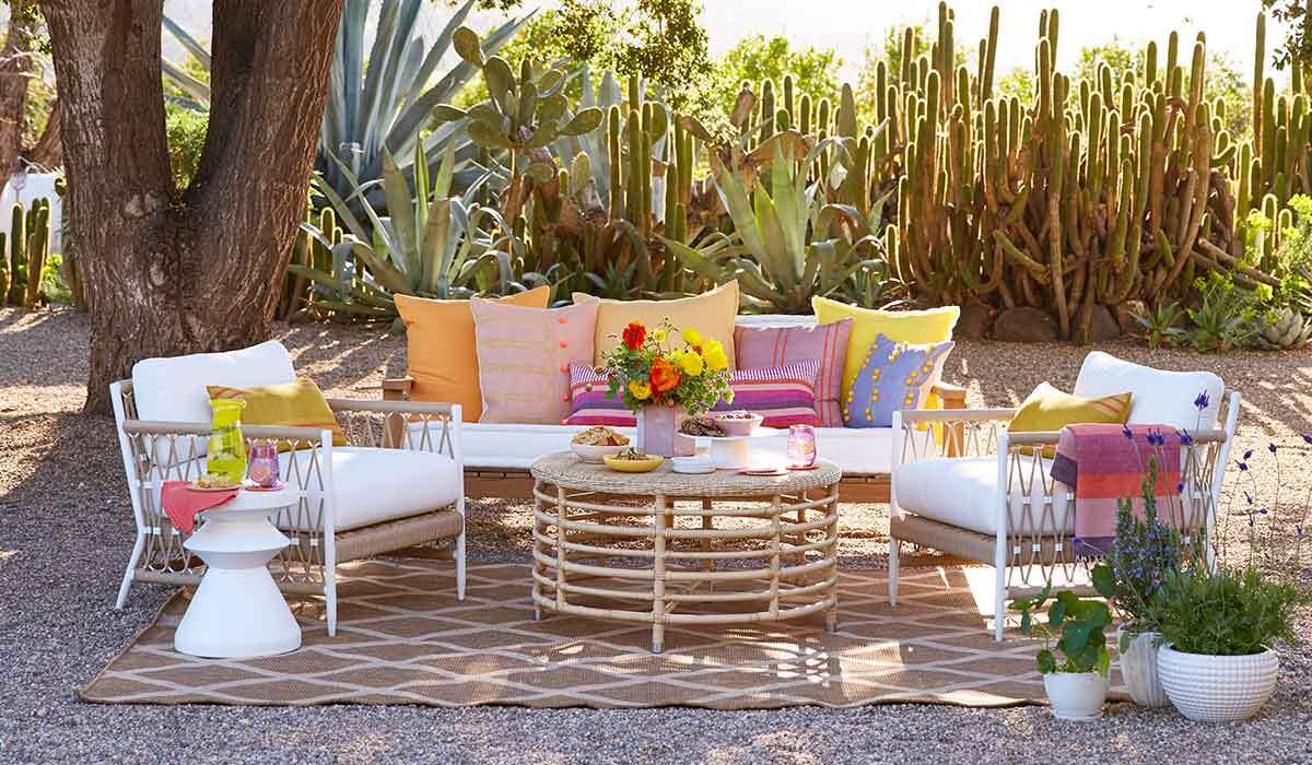 Patio furniture with garden party food and cocktails photo