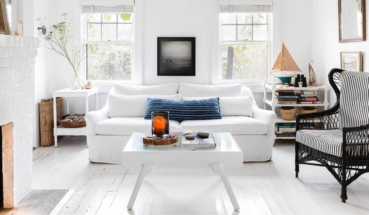 All-white living room with black accents